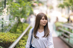 Young woman walking on street with nature (Apricot Cafe) Tags: img96406 asia asianandindianethnicities japan japaneseethnicity shibuyaward tokyojapan capitalcities carefree casualclothing colorimage copyspace day enjoyment happiness harajukudistrict leisureactivity lifestyles longhair nature oneperson oneyoungwomanonly outdoors people photography realpeople selevtivefocus smiling straghthair street summer sustainablelifestyle waistup walking weekendactivities women youngadult shibuyaku tōkyōto jp