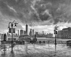 Afternoon Thunderstorm (brianloganphoto) Tags: manhattan northamerica regions newjersey thunderstorm harborsideplaza clouds wtc bw newyork monochrome river nyc newyorkcity landcape hudson conditions unitedstates rain jerseycity storm us