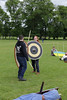 Historia Normannis Meadows June 2018-784 (Philip Gillespie) Tags: historia normannis central scotland sparring fighting shields swords axes spears park grass canon 5dsr men man women woman kids boys girls arms feet hands faces heads legs shins running outdoor tabards chain mail chainmail helmets hats glasses sun clouds sky teams solo dead act acting colour color blue green red yellow orange white black hair practice open tutorial defending attacking volunteer amateur kneeling fallen down jumping pretty athletic activity hit punch