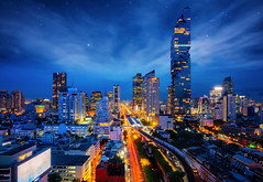 Bangkok city night view from Silom Business center (anekphoto) Tags: building urban travel background reflection office modern town blue transportation bridge asia business architecture road landmark tower downtown skyscraper lights intersection street buildings highway district sunset condominium thai state night city bangkok view cityscape thailand traffic light top sky skyline landscape trails overpass interchange hotel construction scene high transport exterior