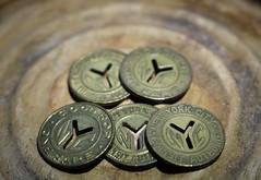 NYC Subway Tokens (vshorty) Tags: macromondays transportation subway token nyc
