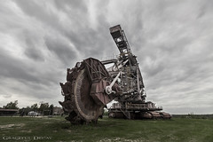 Monster Wheel (Graceful Decay) Tags: abandoned canon clouds decay decayed derelict deserted eos excavator forgotten forsaken gracefuldecay industriekultur industry industrial iron lost lostplaces machine mining miningequipment old opencastmining rust sky tagebau urbanexploration urbex vergessen verlassen wheel