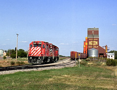 Stockholm SK Monday May 24th 1993 1650CST (Hoopy2342) Tags: train rail railway railroad canadianpacific canadianpacificrailway stockholm sask saskatchewan elevator