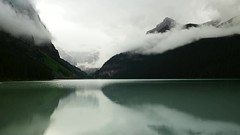 "Lake Louise ""DeLight"" (SeattleEmpress--on the road again) Tags: lake louise banffnationalpark lakelouise alberta canada timelapse fog rain mountains canadianrockies seattleempress stephaniesinclairphotography glacier greenwater glacialwaters canoe boating godrays"