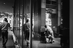 waiting (Zesk MF) Tags: bw black white schwarz weiss boy sitting street candid reflection spiegelung mirror fenster window people city urban zesk