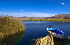 On a floating island / На плавучем острове (Vladimir Zhdanov) Tags: travel peru andes mountains landscape nature altiplano puno titicaca lake water wave boat grass sky cloud urosislands