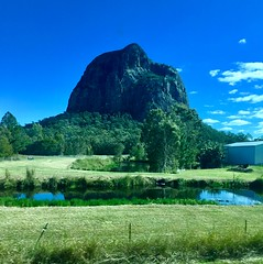 """Glasshouse Mountains. This is an old volcanic plug. The rich soils here are used for growing pineapples. (denisbin) Tags: glasshouse """"glasshouse mountains """" """"volcanic plug"""" volcanic train """"tili train"""" """"tilt"""