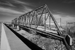 vanishing point (Tomás Harrison Fotos) Tags: nm2 hagerman d750 nikon historic blackandwhite bridge availablelight roadtrip architecture ngc afnikkor24mmf28d landscape nm riofelix austin tx usa