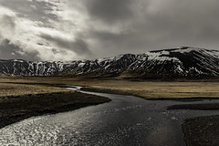 THe Mountain and the River 2 (jessicalowell20) Tags: adventure black brown clouds dramticsky europe flare gold grey iceland landscape lensflare may mountain overcast reflectedlight river rural snow spring summer travel water westiceland white
