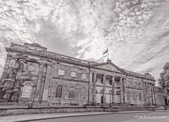 York Castle Museum in black and white (jack cousin) Tags: york yorkshire uk england yorkcastle theeyeofyork building architecture 18thcentury touristattraction tourism travel windows stone stonework door columns sky dramaticsky pavement footpath grass lawn tree foliage museum flagpole flag lamp lamppost seat bench blackandwhite nikond610 on1photos
