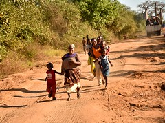 Running for a Ride (Rod Waddington) Tags: africa african afrique afrika madagascar malagasy people running road truck group children women outdoor