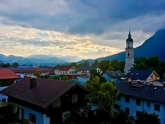 Cloudy morning over Kiefersfelden, Bavaria, Germany (UweBKK (α 77 on )) Tags: cloudy clouds grey golden sun ray morning dawn early city province town church bell tower mountains kiefersfelden bavaria bayern germany deutschland europa europe iphone