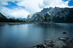 180/365: Out of the blue (judi may) Tags: 365the2018edition 3652018 day180365 29jun18 canada lake lakeminnewanka water mountains rockymountains rocks longexposure blue sky clouds cloudysky landscape canon5d