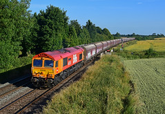 66783 Biffa/GBRf 'The Flying Dustman' works 4M86 Ely Papworth - Wellingborough Yard at Ashwell (Iain Wright Photography) Tags: pole harris 5metre nikon d7200 35mm f18 prime iso 320 f80 11000 gbrf gbrailfreight biffa bins class66 shed 4m86 ely cemex papworth potter stone sidings wellingborough gb railfreight yard orange red maroon yellow fields hta hoppers buckeye