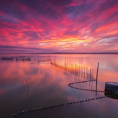 Albufera Memories. (dasanes77) Tags: canoneos6d canonef1635mmf4lisusm tripod landscape seascape cloudscape waterscape water clouds sky dramaticsky red orange colors blue reflections shadows nets lake lines horizon calm tranqulity albuferaofvalencia valencia