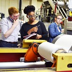 Paper Science and Engineering students discuss parts of the Wolfpack Baby Paper Machine