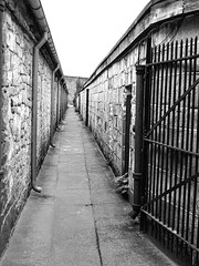 Walkin' In the Rain (nelhiebelv) Tags: easternstatepenitentiary alley walk yard narrow
