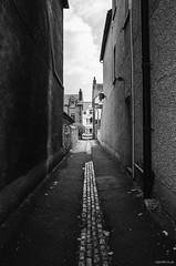 Alley (Roj) Tags: originalphotographers alley ricohgrii sourcerojsmithtumblrcom vanashingpoint mono photographersontumblr car bw blackandwhite monochrome