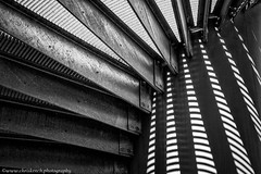 Under the stairs (www.chriskench.photography) Tags: shadow germany munich wwwchriskenchphotography fujifilm light stairs spiralstaircase copyright monochrome travel xt2 staircase spiral architecture steps kenchie europe bw blackandwhite münchen bayern de bmw