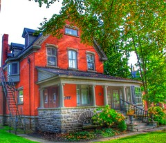 Brockville Ontario - Canada -  207 King Street East - Home of Col. James Walsh  - Indian Cliff (Onasill ~ Bill Badzo) Tags: brockville ontario on ont canada 181 king street st e east hwy 2 kinghwy waterfront lakeontario heritage historic historical house mansion victorian second empire architecture style mansard roof fish scale shingles flowers portico door shutters tower gill co mfg renovated broome onasill canon eos rebel sl1 18250mm sigma macro lens telephoto garden tree building kings mary grenvillecounty leedscounty grass window road 207 home colonel col james walsh indian cliff sitting bull chief
