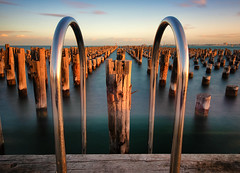 The pier (Pat Charles) Tags: princespier newrailwaypier portmelbourne jetty pier melbourne victoria australia longexposure tripod sunset evening beach ocean sea water pylons wood decrepit old ruin handles depthoffield portphillipbay bay leadinglines nikon filter nd neutraldensity