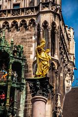 Views from a village of a million People (Tony Shertila) Tags: münchen bayern germany deu 20170825122458germanymunichlr europe munich munchen bavaria statue city architecture building mythology townhall golden
