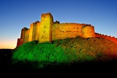 Bamburgh Castle at night, Northumbria (iancowe) Tags: bamburgh castle night evening illuminated lit northumbria northumberland colours floodlit floodlighting england english coast ne northeast dusk blue hour gloaming