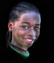 All You Gotta Know ... (daystar297) Tags: streetportrait portrait kid child beautiful black africanamerican boy sweet braids hair smile face closeup peace love nikon