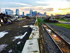 """Phoenix Rising"" (Halvorsong) Tags: nashville america americana urban industry industrial street road roadside sunset wow photosafari decay abandoned industrialphotography metal railroad tracks skyline cityscape landscape photography art contrast composition darkness light rust junk junkyard halvorsong"