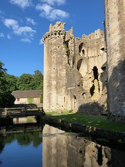 Nunney Castle near Frome in Somerset (baldychops) Tags: moated medieval water bridge moat ruin village evening peaceful beautiful quiet idyllic summer outdoor architecture building historic history reflection old castle nunneycastle somerset nunney