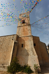 The church of Santa Maria (paul indigo) Tags: oliena paulindigo santamaria sardinia architecture bunting church clock flags tower