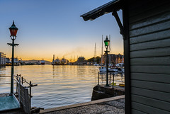 Life at the pier (kraakenes) Tags: dusk dawn seascape cityscape travel pier harbour ship sailboat summer spring nightphoto skyscape