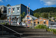 The Blue Building is to be Repaired (Jocey K) Tags: lyttelton bankspeninsula newzealand christchurch nikond750 buildings architecture steps plants houses sky clouds artwork hills