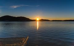 Sunrise Waterscape with Sunburst (Merrillie) Tags: daybreak woywoy landscape nature australia foreshore newsouthwales earlymorning nsw brisbanewater sunburst morning dawn coastal water sky waterscape sunrise centralcoast bay outdoors