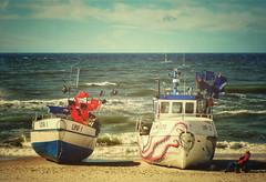 Fishing boats on the beach (Maciej Lemanik) Tags: baltic wave sea sand sun light texture unieście mielno