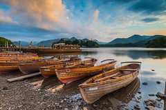 Derwent Boats (James Whitlock Photography) Tags: europe uk england lake district keswick derwent water reflection sun sunset rowing boats shower cloud sky colour nikon d810 gitzo lee filters