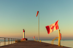 Flag (Stefen Acepcion) Tags: canada canadaday ontario oakville sky harbor lake shore lighthouse new morning light flag nationalism concrete golden july summer heat