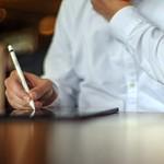 An investor takes notes thumbnail