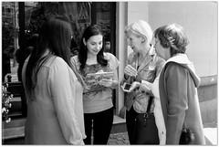 Katherine registers the visitors to the coffee tasting. (Ігор Кириловський) Tags: 135 35mm bw kyrylovskyy kirilovskiyigor lviv ukraine viewfinder agfaoptima1035sensor agfa solitars40mmf28 film kodak400tmax rodenstockyellowmedium8 markstudiolab chernivtsi