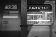 QUEENS BLVD EXP (John St John Photography) Tags: streetphotography candidphotography etrain 34thstreet subwaystation mta newyorkcity newyork queensblvdexp blur youngwoman pennstation bw blackandwhite blackwhite blackwhitephotos johnstjohnphotography