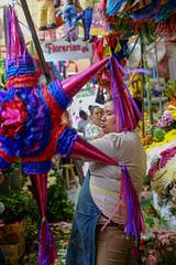 Buying a Piñata (Nomade Moderne) Tags: piñata mexico colors market mercado celebration sanmigueldeallende