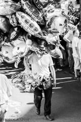 Vendeur de ballons (Pamprelune eye) Tags: streetphotography blackandwhite bnw city worker noiretblanc monochrome street ballons baloons france lorient festivalinterceltique portrait streetportrait
