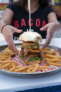 Bacon Nation's Golden Burger | 5 oz. beef patty, with maple bacon, peameal bacon, Canadian cheddar, onion rings, jalapenos, lettuce, tomato, chipotle mayo