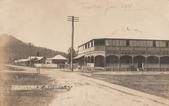 Exchange Hotel in Mossman, Qld - very early 1900s (Aussie~mobs) Tags: vintage queensland australia pub exchangehotel hotel streetscape telegraphpole houses homes residences