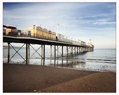 Pier (breakbeat) Tags: hipstamatic jane blanko iphoneonly paignton devon travel trip holiday british seaside dusk sunset summer colourful redbeach sand pier beachhuts painted