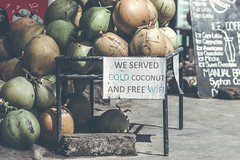Coconuts for sale on a roadside on Bali island, Indonesia. (Artem Bali) Tags: sale coconuts shop roadside tender food coconut fruit fresh closeup tropical healthy green natural market background organic summer asia ripe drink sweet nature delicious agriculture juice raw exotic thailand vegetarian cut texture refreshment produce tasty table tourism mature business decoration health retail bunch ingredient color selling srilanka nutrition plant local