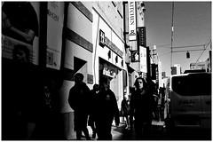 Uniform Life (Harald Philipp) Tags: architecture building structure urban city street sidewalk pavement outdoors people students uniforms highschoolstudents van holiday vacation tourism tourist destination travel adventure wanderlust blackandwhite bw monochrome schwarzweiss grauzone nocolor dark shadows contrast nikon nikkor d810 day sky cloudless morning australia melbourne chinatown advertising billboard sign shops restaurants walking outing class blackwhite