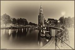Amsterdam. (alamsterdam) Tags: amsterdam montelbaanstoren longexposure canal oudeschans bikes reflections geotagged old houseboats evening 2215