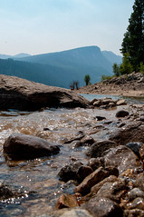 Stone Shore (Cj Good) Tags: lake landscape rocks rocky shore mountains boulder montana hiking clear water