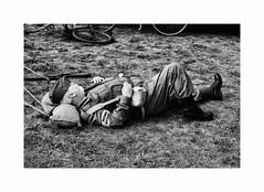 Who do you think you are kidding Mr H ? (CJS*64) Tags: panasonic panasoniclx100 dadsarmy army rest resting toomuch people lyingdown blackwhite bw blackandwhite whiteblack whiteandblack cjs64 craigsunter cjs 1940 1940festival lytham
